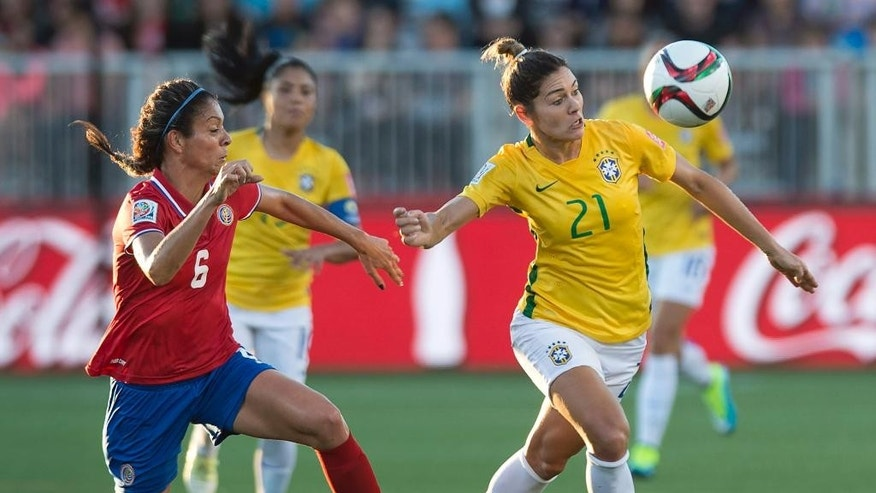 Brazil's Gabriela, right, and Costa Rica's Carol Sanchez race for the ball during the first half of a FIFA Women's World Cup soccer game in Moncton, New Brunswick, Canada, on Wednesday, June 17, 2015. (Andrew Vaughan/The Canadian Press via AP)