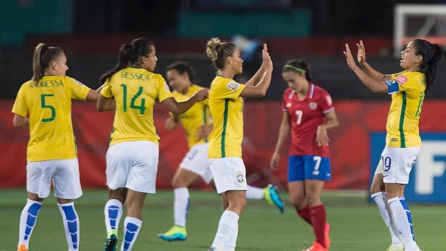 Brazil celebrates after Raquel Fernandes scored against Costa Rica during the second half of a FIFA Women's World Cup soccer game in Moncton, New Brunswick, Canada, on Wednesday, June 17, 2015. (Andrew Vaughan/The Canadian Press via AP)