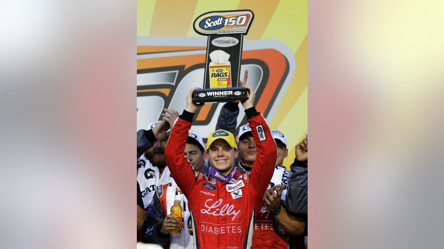 Ryan Reed holds up the trophy in Victory Lane after winning the ARCA auto race at Chicagoland Speedway, Saturday, June 20, 2015, in Joliet, Ill. (AP Photo/Nam Y. Huh)