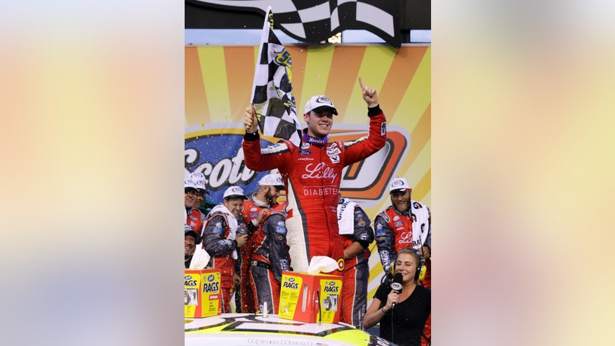 Ryan Reed celebrates with his crew after winning the ARCA auto race at Chicagoland Speedway, Saturday, June 20, 2015, in Joliet, Ill. (AP Photo/Nam Y. Huh)