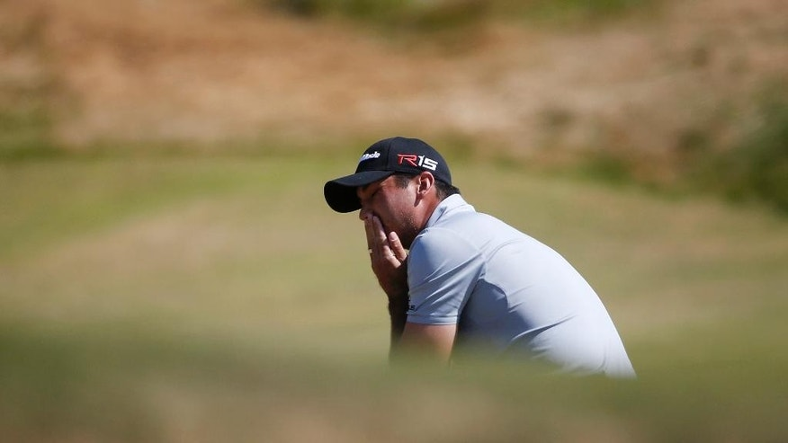 Jason Day, of Australia, reacts after missing a putt on the ninth hole during the third round of the U.S. Open golf tournament at Chambers Bay on Saturday, June 20, 2015 in University Place, Wash. (AP Photo/Lenny Ignelzi)
