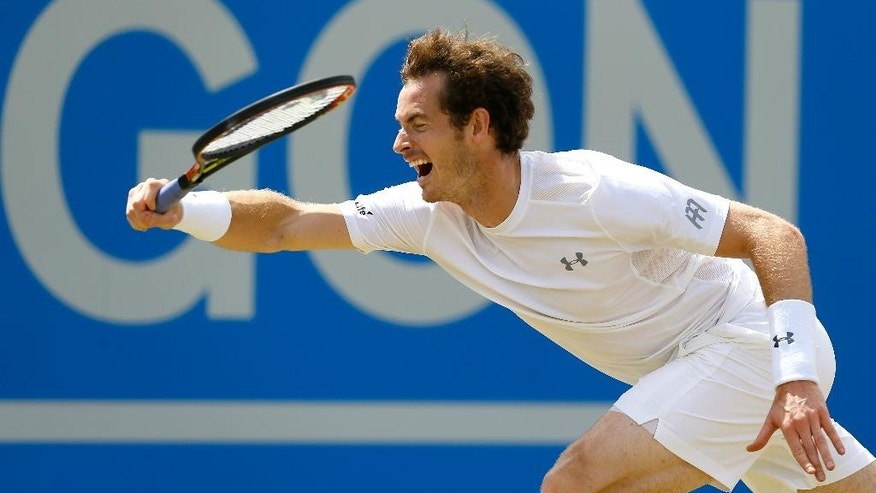 Andy Murray of Britain plays a return to Viktor Troicki of Serbia during their semifinal tennis match at the Aegon Championships in London, Sunday, June 21, 2015. (AP Photo/Kirsty Wigglesworth)