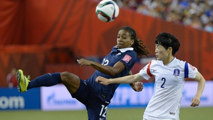 France's Elodie Thomis plays the ball against South Korea's Lee Eunmi during first half FIFA Women's World Cup soccer action   in Montreal, Canada, Sunday, June 21, 2015. (Paul Chiasson/The Canadian Press via AP) MANDATORY CREDIT