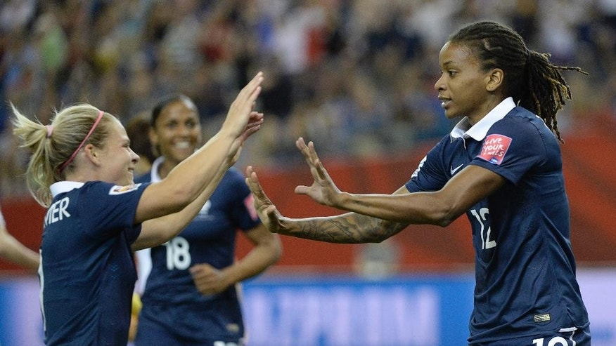 France's Elodie Thomis, right, celebrates her goal against South Korea with teammate Eugenie Le Sommer during first half FIFA Women's World Cup soccer action Sunday, June 21, 2015 in Montreal, Canada. (Paul Chiasson/The Canadian Press via AP)