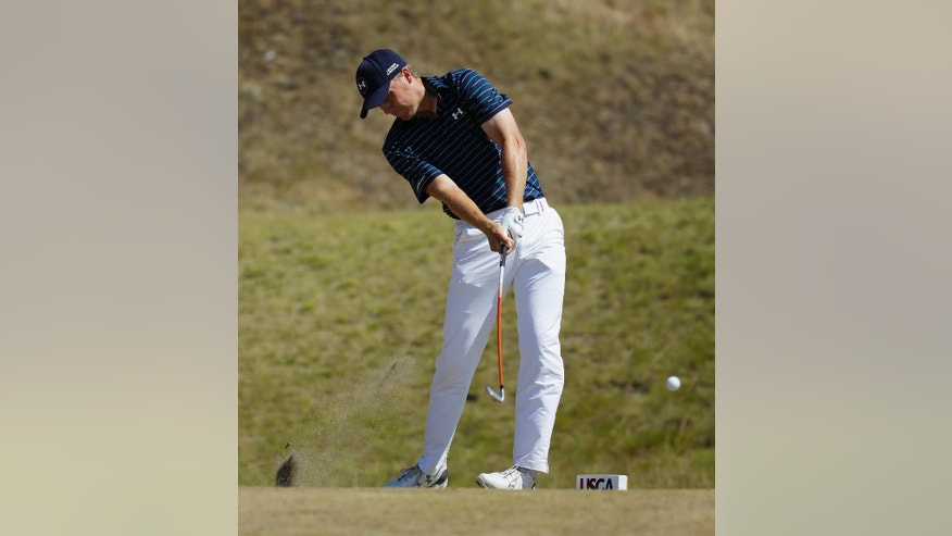 Jordan Spieth hits his tee shot on the fifth hole during the final round of the U.S. Open golf tournament at Chambers Bay on Sunday, June 21, 2015 in University Place, Wash. (AP Photo/Ted S. Warren)
