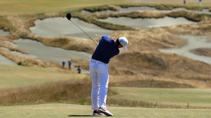 Rory McIlroy, of Northern Ireland, watches his tee shot on the fourth hole during the final round of the U.S. Open golf tournament at Chambers Bay on Sunday, June 21, 2015 in University Place, Wash. (AP Photo/Ted S. Warren)