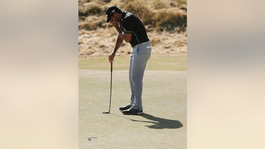 Jason Day, of Australia, reacts to his missed putt on the 11th hole during the final round of the U.S. Open golf tournament at Chambers Bay on Sunday, June 21, 2015 in University Place, Wash. (AP Photo/Charlie Riedel)