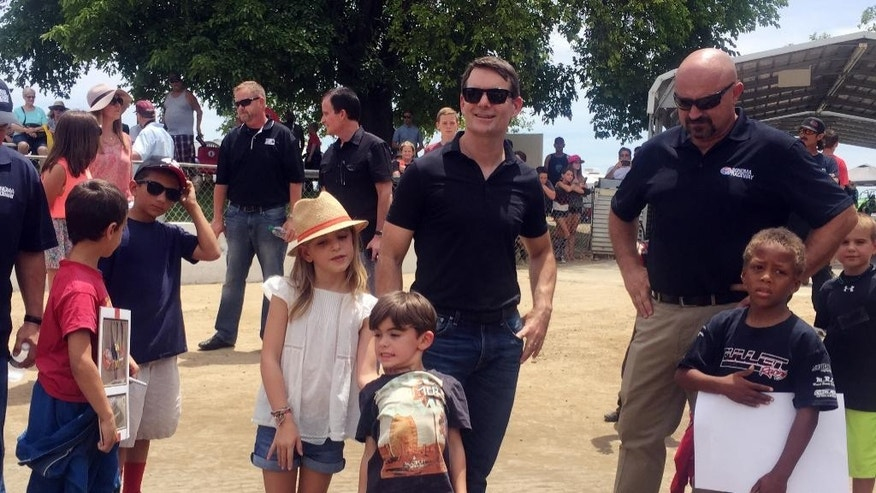 In this photo taken Saturday, June 20, 2015, NASCAR driver Jeff Gordon shows his children, Ella and Leo, around Roy Hayer Memorial Speedway in Rio Linda, Calif. Gordon began his career at the quarter-midget dirt track when he was 5 and the track was called Cracker Jack Track. (AP Photo/Jenna Fryer)