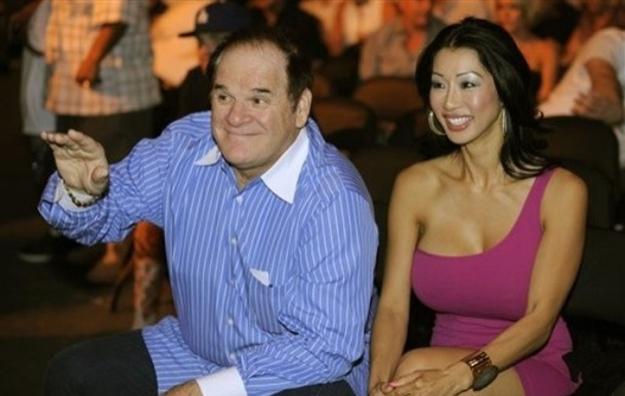 Sept, 26, 2009: Former major league baseball player Pete Rose, left, is joined by an unidentified companion before the start of a heavyweight fight between Vitali Klitschko and Chris Arreola in Los Angeles.  (AP)