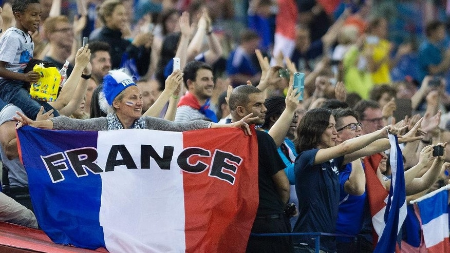 France fans celebrate after their team defeated South Korea 3-0 in their FIFA Women's World Cup round of 16 soccer game, Sunday, June 21, 2015 in Montreal, Canada. (Graham Hughes/The Canadian Press via AP)