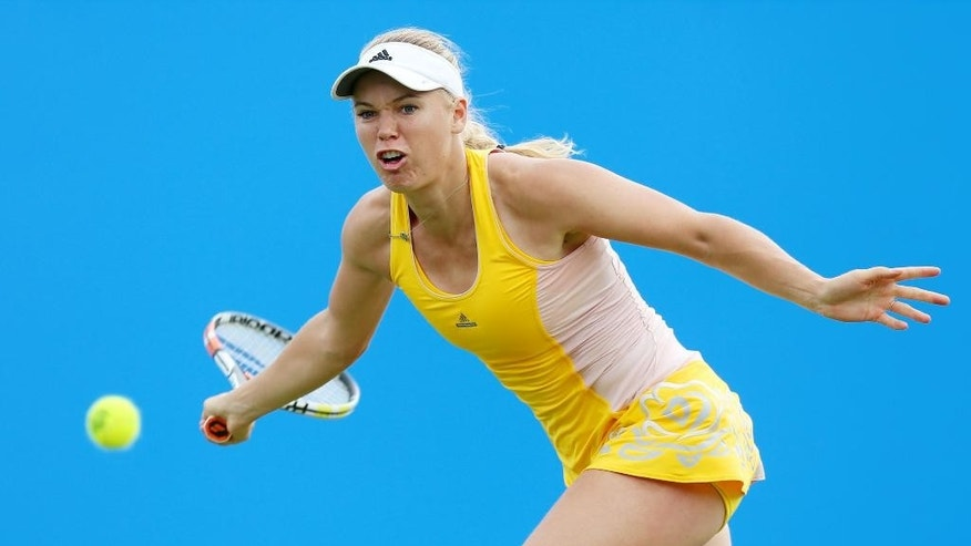Denmark's Caroline Wozniacki in action against Australia's Jarmila Gajdosova during day four of the women's International tennis at Devonshire Park, Eastbourne, England, Tuesday June 23, 2015. (Gareth Fuller/PA via AP) UNITED KINGDOM OUT  NO SALES   NO ARCHIVE