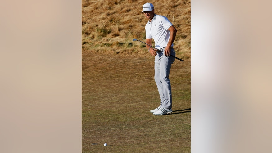 Dustin Johnson misses his eagle putt on the 18th hole during the final round of the U.S. Open golf tournament at Chambers Bay on Sunday, June 21, 2015 in University Place, Wash. (AP Photo/Matt York)