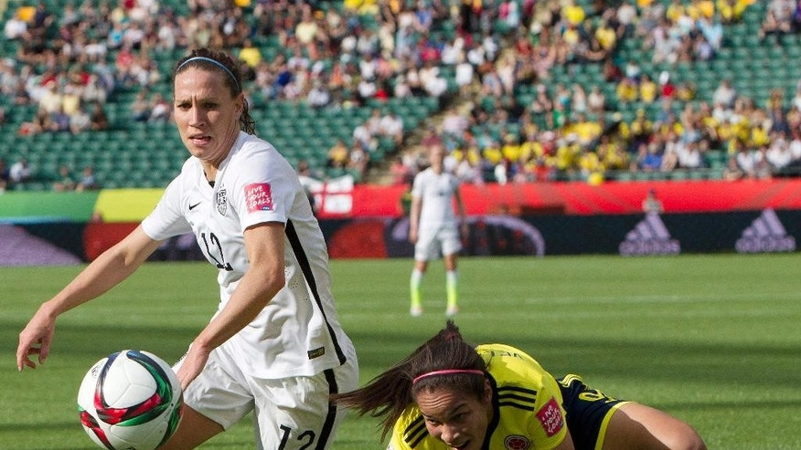 United States' Lauren Holiday (12) and Colombia's Orianica Velasquez (9) watch the ball during first half FIFA Women's World Cup round of 16 soccer action in Edmonton, Alberta, Canada, Monday, June 22, 2015.  (Jason Franson/The Canadian Press via AP) MANDATORY CREDIT