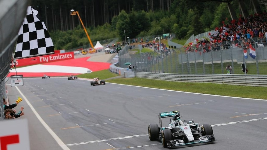 Mercedes driver Nico Rosberg of Germany crosses the finish line to win the Austrian Formula One Grand Prix race at the Red Bull Ring in Spielberg, southern Austria, Sunday, June 21, 2015. (Valdrin Xemay, Pool Photo via AP)