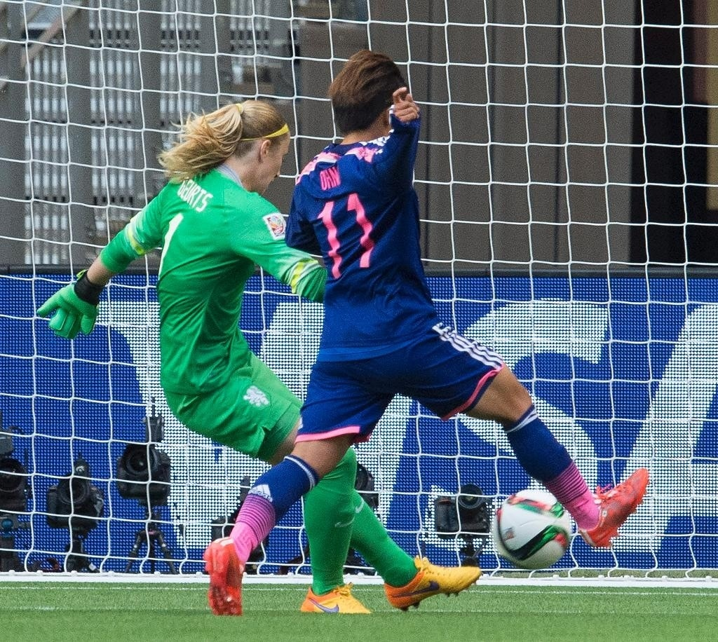 Defending World Cup champion Japan beats the Netherlands 2-1 to reach Saturday quarterfinal