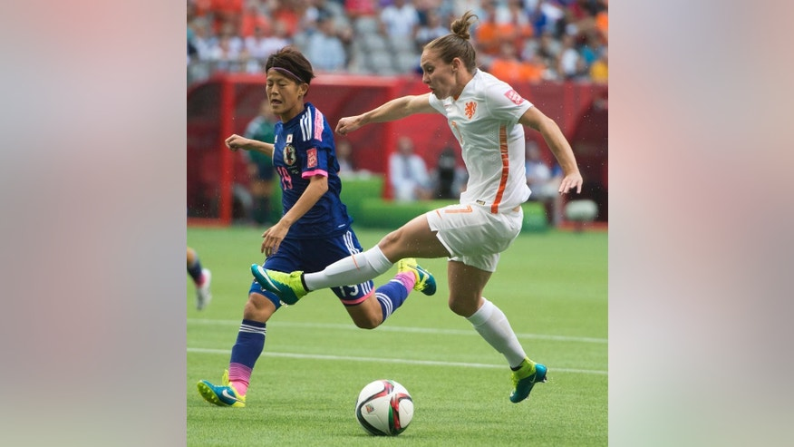 Netherlands' Manon Melis (7) fights for control of the ball with Japan's Saori Ariyoshi (19) during the first half of a round of 16 soccer match at the FIFA Women's World Cup, Tuesday, June 23, 2015, in Vancouver, British Columbia, Canada. (Jonathan Hayward/The Canadian Press via AP)
