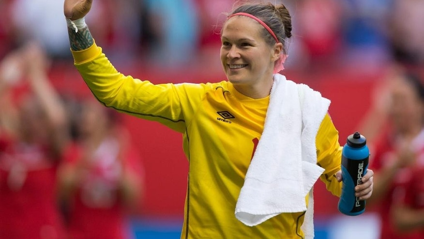 Canada goalkeeper Erin McLeod waves to fans after defeating Switzerland 1-0 in the FIFA Women's World Cup round of 16 soccer action in Vancouver, British Columbia, Canada, Sunday, June 21, 2015. (Darryl Dyck/The Canadian Press via AP) MANDATORY CREDIT