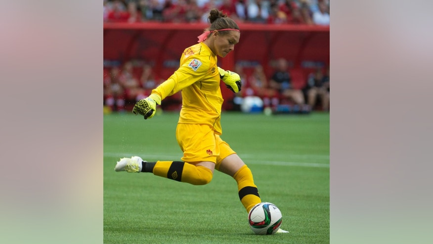 Canada goalkeeper Erin McLeod kicks the ball during first half of the FIFA Women's World Cup round of 16 soccer action in Vancouver, British Columbia, Canada, Sunday, June 21, 2015. (Jonathan Hayward/The Canadian Press via AP) MANDATORY CREDIT