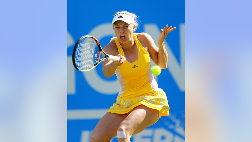 Denmark's Caroline Wozniacki in action during her victory against Germany's Andrea Petkovic on day six of the AEGON International at Devonshire Park, Eastbourne, southeastern England, Thursday June 25, 2015. (Gareth Fuller/PA via AP) UNITED KINGDOM OUT  NO SALES  NO ARCHIVE