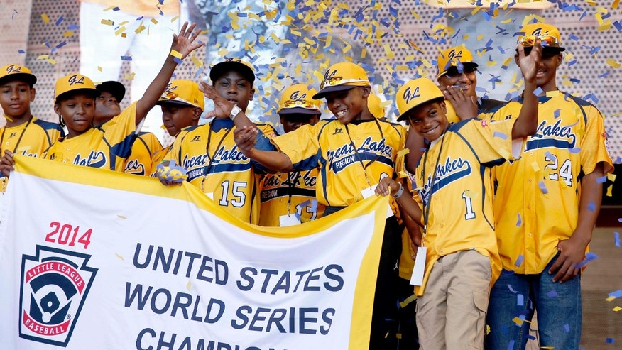 Aug. 27, 2014: Members of the Jackie Robinson West All Stars Little League baseball team participate in a rally celebrating the team's U.S. Little League Championship in Chicago.