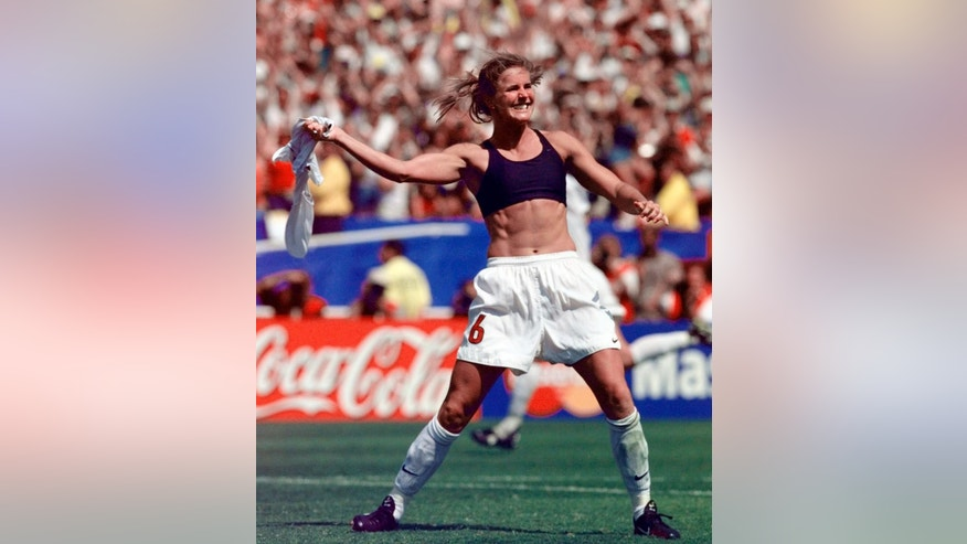 FILE - In this July 10, 1999, file photo, the United States' Brandi Chastain celebrates by taking off her jersey after kicking in the game-winning goal in penalty shootout goal against China in the FIFA Women's World Cup Final at the Rose Bowl in Pasadena, Calif. The last time the United States played China was at the World Cup final in 1999. The two countries play on Friday in the quarterfinals of the FIFA Women's World Cup in Canada. (AP Photo/Mark J. Terrill, File)