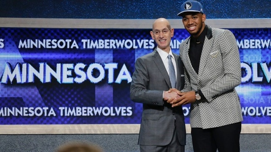 June 25, 2015: Karl-Anthony Towns, right, poses for photos with NBA commissioner Adam Silver after being selected first overall by the Minnesota Timberwolves during the NBA basketball draft in New York. (AP Photo/Julie Jacobson)
