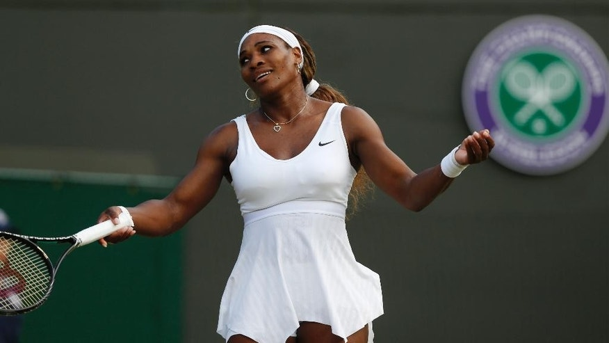 FILE - In this June 28, 2014, file photo, Serena Williams gestures during a women's singles match against Alize Cornet of France at the All England Lawn Tennis Championships in Wimbledon, London. A five-time champion and two-time runner-up at Wimbledon, Serena Williams hasn't been past the fourth round either of the last two years at the All England Club. (AP Photo/Sang Tan, File)