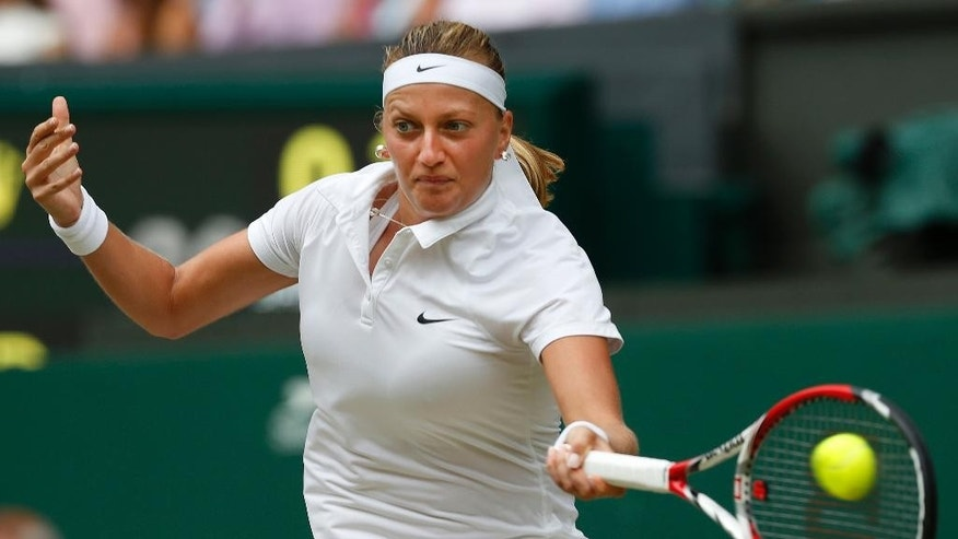 FILE - In this July 5, 2014, file photo, Petra Kvitova of the Czech Republic plays a return to Eugenie Bouchard of Canada during the women's singles final at the All England Lawn Tennis Championships in Wimbledon, London. Kvitove has made it to at least the quarterfinals at the All England Club each of the last five years. (AP Photo/Sang Tan, File)