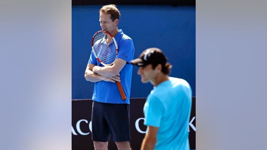 FILE - In this Jan. 23, 2014, file photo, Switzerland's Roger Federer, right, practices along with his coach and former Grand Slam champion Stefan Edberg at the Australian Open tennis championship in Melbourne, Australia. Federer, who turns 34 in August, lost in last year's final to Novak Djokovic and knows full well that the best and most likely place for him to add to his Grand Slam collection is Wimbledon. He is capable of being nearly as dangerous as ever, especially with a more-aggressive, net-charging approach under coach Stefan Edberg.   (AP Photo/Aijaz Rahi, File)