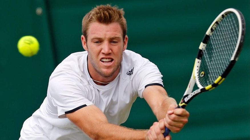 FILE - In this June 26, 2014, file photo, Jack Sock, of the United States, returns a shot to Milos Raonic, of Canada, during their men's singles match at the All England Lawn Tennis Championships at Wimbledon, London, England. Which of the younger set in men's tennis might make a statement this year? There's a trio of talented Australians, all 22 or under, Nick Kyrgios (who beat Rafael Nadal at the All England Club in 2014); Bernard Tomic (a quarterfinalist in 2011); Thanasi Kokkinakis, and others such as Jack Sock of the U.S., Dominic Thiem of Austria, and Borna Coric of Croatia.  (AP Photo/Ben Curtis, File)
