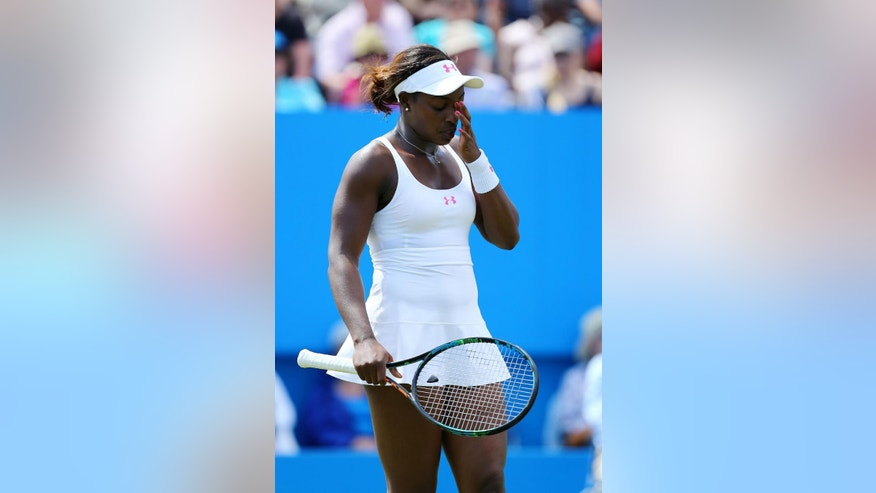 Sloane Stephens of the United States pauses as she plays Poland's Agnieszka Radwanska during day seven of the international women's tournament at Eastbourne, England, Friday June 26, 2015. (Gareth Fuller/PA via AP) UNITED KINGDOM OUT  NO SALES  NO ARCHIVE
