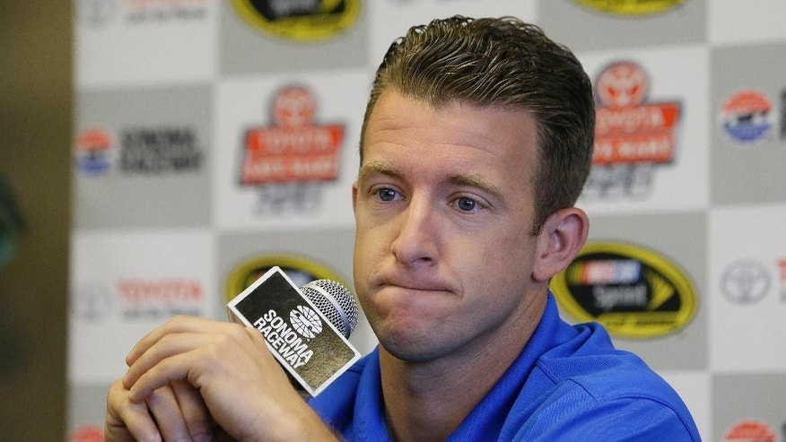 A.J. Allmendinger answers questions at a news conference before practice for the NASCAR Sprint Cup Series auto race Friday, June 26, 2015, in Sonoma, Calif. Allmendinger earned a spot in the championship race with a win on a road course. He'll try to do it again this year at Sonoma Raceway, the first of two road courses on the NASCAR schedule. (AP Photo/Eric Risberg)