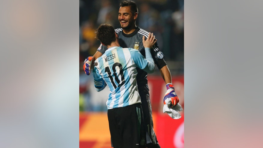 Argentina's Lionel Messi celebrates with teammate goalkeeper Sergio Romero  after the penalty shootout during a Copa America quarterfinal soccer match at the Sausalito Stadium in Vina del Mar, Chile, Friday, June 26, 2015. Argentina defeated Colombia 5-4 on penalties after a 0-0 draw on Friday to reach the semifinals of the Copa America.(AP Photo/Andre Penner)