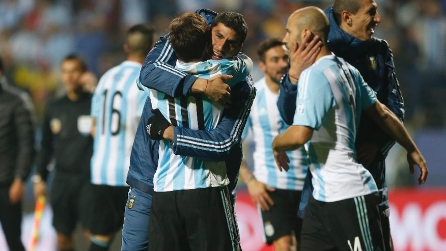 Argentina's Lionel Messi celebrates with teammates after the penalty shootout during a Copa America quarterfinal soccer match at the Sausalito Stadium in Vina del Mar, Chile, Friday, June 26, 2015. Argentina defeated Colombia 5-4 on penalties after a 0-0 draw on Friday to reach the semifinals of the Copa America.(AP Photo/Andre Penner)