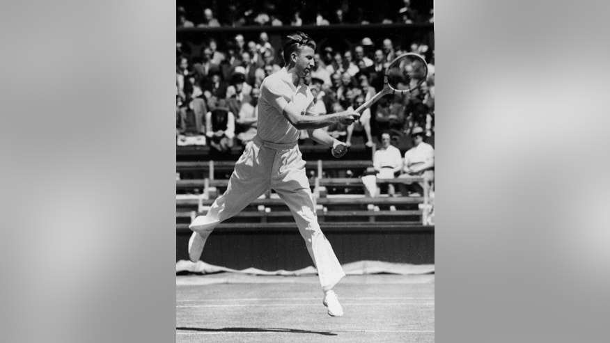 FILE - In this July 1, 1938 file photo, Donald Budge of the U.S. returns a shot, at the All England Lawn Tennis Championships in Wimbledon, London. In winning his second straight Wimbledon title in 1938,  Budge took a step to winning tennis' Grand Slam of all four major titles. A few weeks later at the U.S. national championships, the Californian would become the first tennis player, male or female, to achieve that feat. (AP Photo, File)