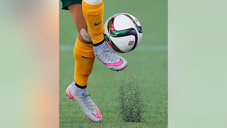 FILE - In this June 12, 2015, file photo, Australia's Samantha Kerr controls the ball during the second half of a FIFA Women's World Cup soccer game against Nigeria in Winnipeg, Manitoba, Canada. The fields are heating up, there are little black rubber pellets everywhere, and feet are covered with blisters.  The use of artificial turf at this year's tournament in Canada has been a contentious issue with the players since it was included in the nation's bid in 2011. (John Woods/The Canadian Press via AP, File)
