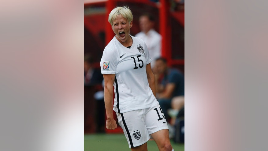 FILE - In this Monday, June 8, 2015, file photo, United States' Megan Rapinoe celebrates her goal against Australia during a FIFA Women's World Cup soccer match in Winnipeg, Manitoba, Canada. The United States has made it to the quarterfinals but will have to face China on Friday without two key players. Midfielders Lauren Holiday and Megan Rapinoe are out because of accumulated yellow cards.  (John Woods/The Canadian Press via AP, File) MANDATORY CREDIT