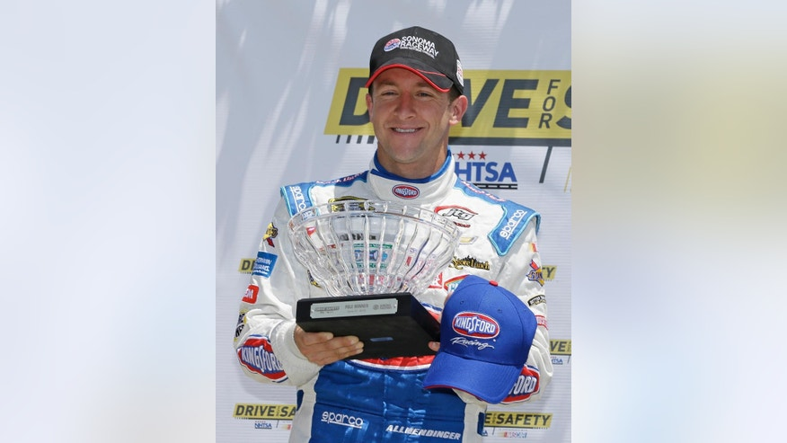 A.J. Allmendinger poses with his award after winning the pole position while qualifying for the NASCAR Sprint Cup Series auto race Saturday, June 27, 2015, in Sonoma, Calif. (AP Photo/Eric Risberg)