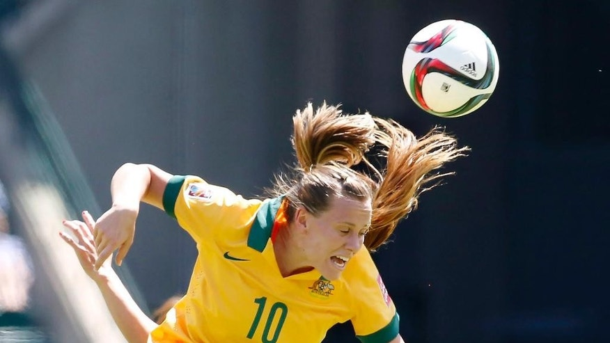 Australia's Emily van Egmond heads a ball during first half FIFA Women's World Cup quarter-final soccer action against Japan in Edmonton, Alta., Saturday, June 27, 2015.  (Jeff McIntosh/The Canadian Press via AP) MANDATORY CREDIT