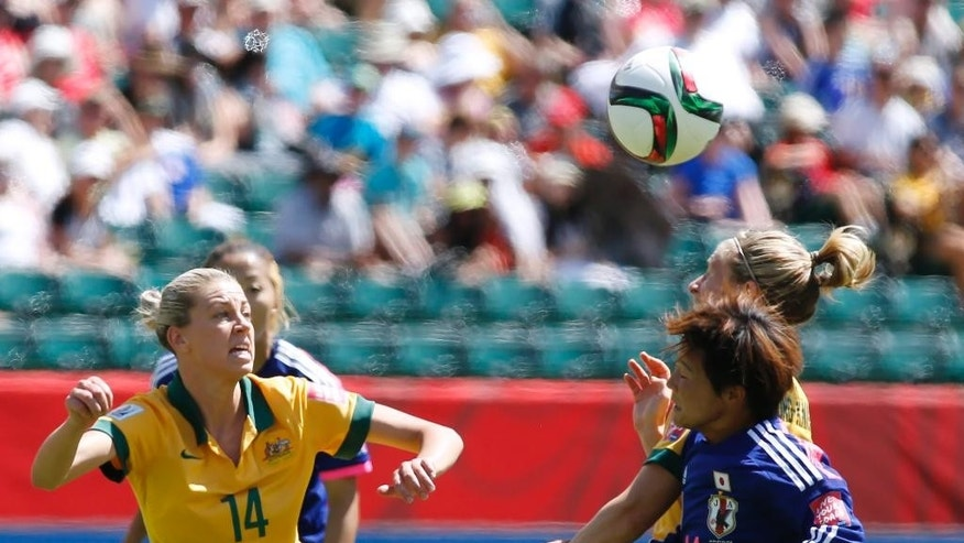 Japan's Shinobu Ohno (11) is challenged by Australia's Elise Kellond-Knight, rear right, as Alanna Kennedy (14) looks on during first half FIFA Women's World Cup quarter-final soccer action in Edmonton, Alberta, Canada, Saturday, June 27, 2015.   (Jeff McIntosh/The Canadian Press via AP) MANDATORY CREDIT