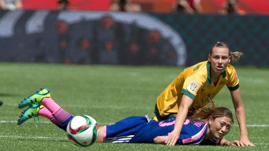 Japan's Rumi Utsugi (13) and Australia's Emily van Egmond (10) vie for the ball during the first half of a FIFA Women's World Cup quarter-final soccer match in Edmonton, Alberta, Canada, on Saturday, June 27, 2015. (Jason Franson/The Canadian Press via AP) MANDATORY CREDIT