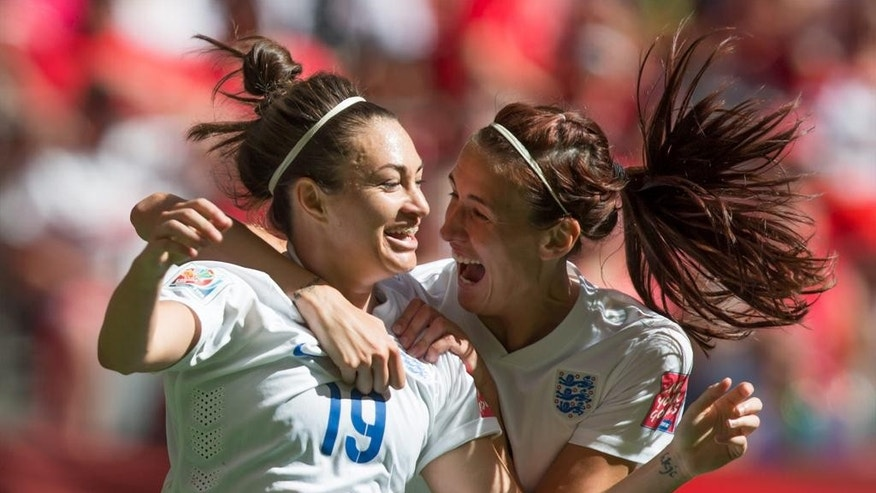England's Jodie Taylor, left, and Jill Scott celebrate Taylor's goal against Canada during the first half in a quarterfinal of the Women's World Cup soccer tournament, Saturday, June 27, 2015, in Vancouver, British Columbia, Canada. (Darryl Dyck/The Canadian Press via AP