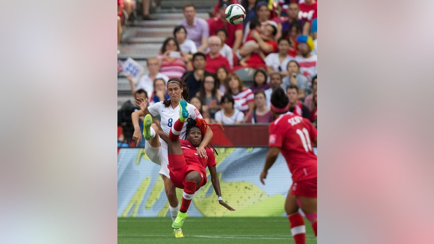 England's Jill Scott, left, and Canada's Kadeisha Buchanan tangle going for the ball during first half FIFA Women's World Cup quarter-final soccer action in Vancouver, British Columbia, Canada, on Saturday June 27, 2015. (Darryl Dyck/The Canadian Press via AP) MANDATORY CREDIT
