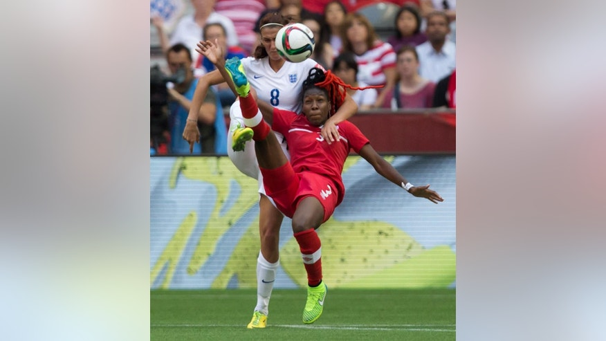 England's Jill Scott, left, and Canada's Kadeisha Buchanan vie for the ball during first-half FIFA Women's World Cup quarterfinal soccer game action in Vancouver, British Columbia, Canada, on Saturday, June 27, 2015. (Darryl Dyck/The Canadian Press via AP) MANDATORY CREDIT