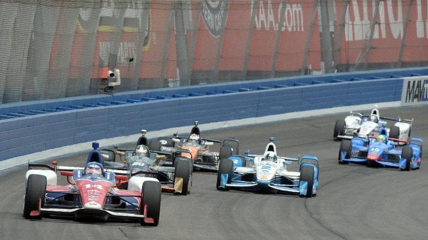 Takuma Sato (14), from Japan, leads during the early laps Saturday, June 27, 2015, during the IndyCar auto race at Auto Club Speedway in Fontana, Calif. (AP Photo/Will Lester)