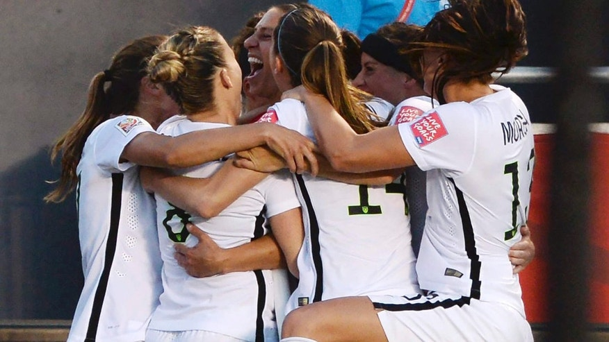 June 26, 2015: U.S. players celebrate a goal by Carli Lloyd (10) against China during the second half of a quarterfinal match in the FIFA Women's World Cup soccer tournament.