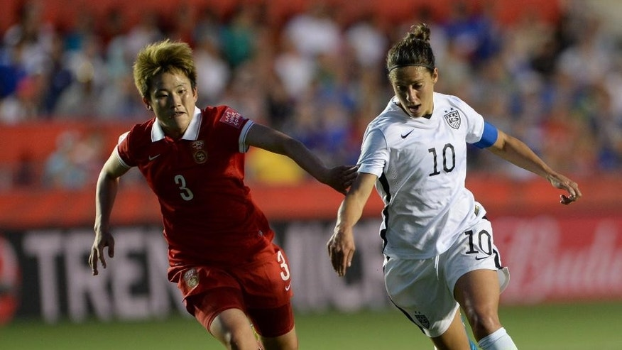 China's Pang Fengyue (3) chases United States' Carli Lloyd (10) during the second half of a quarterfinal match in the FIFA Women's World Cup soccer tournament, Friday, June 26, 2015, in Ottawa, Ontario, Canada. (Sean Kilpatrick/The Canadian Press via AP)