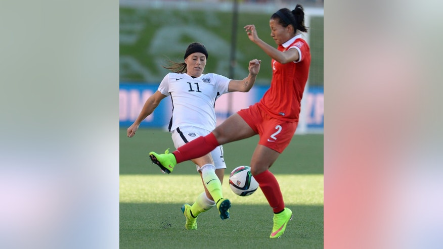 United States' Ali Krieger (11) and China's Liu Shanshan (2) battle for the ball during the first half of a quarterfinal match in the FIFA Women's World Cup soccer tournament, Friday, June 26, 2015, in Ottawa, Ontario, Canada. (Adrian Wyld/The Canadian Press via AP)
