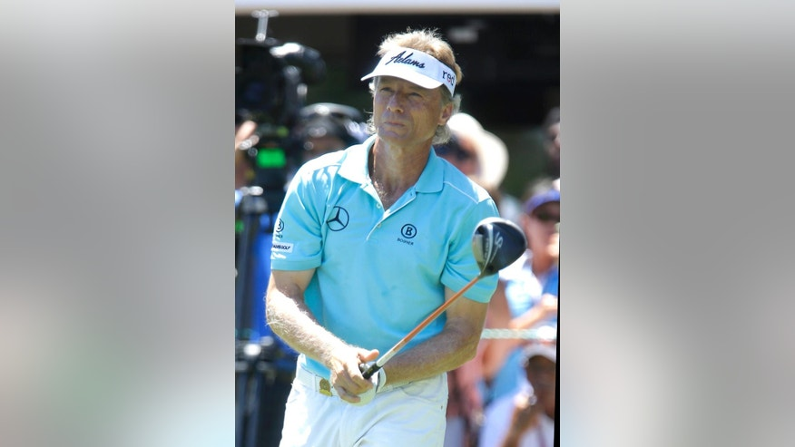 Bernhard Langer, of Germany, watches his tee shot on the first hole in the final round of the U.S. Senior Open golf tournament at Del Paso Country Club in Sacramento, Calif., Sunday, June 28, 2015. (AP Photo/Rich Pedroncelli)