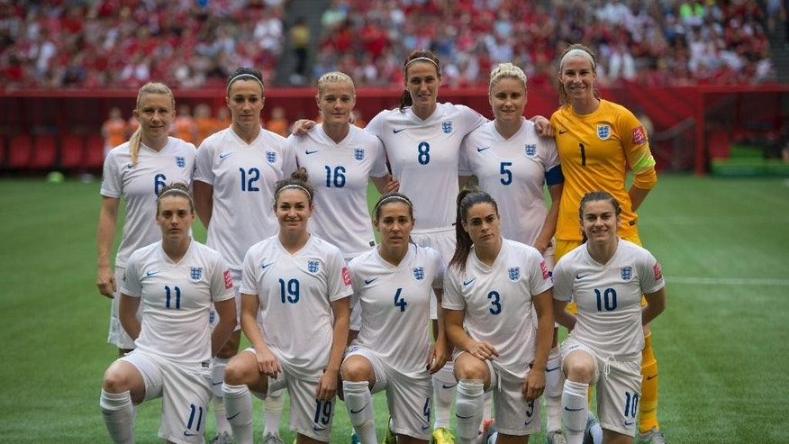 The England squad poses for a photo prior to a quarterfinal against Canada in the Women's World Cup soccer tournament, Saturday, June 27, 2015, in Vancouver, British Columbia, Canada. (Jonathan Hayward/The Canadian Press via AP)